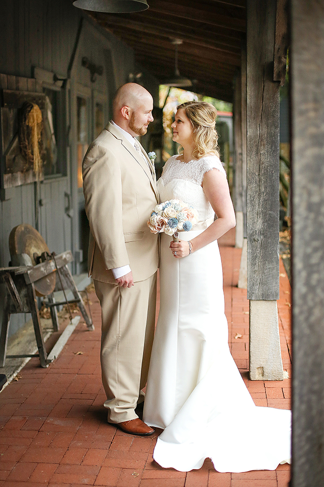 Photo of Bride and groom in Stables