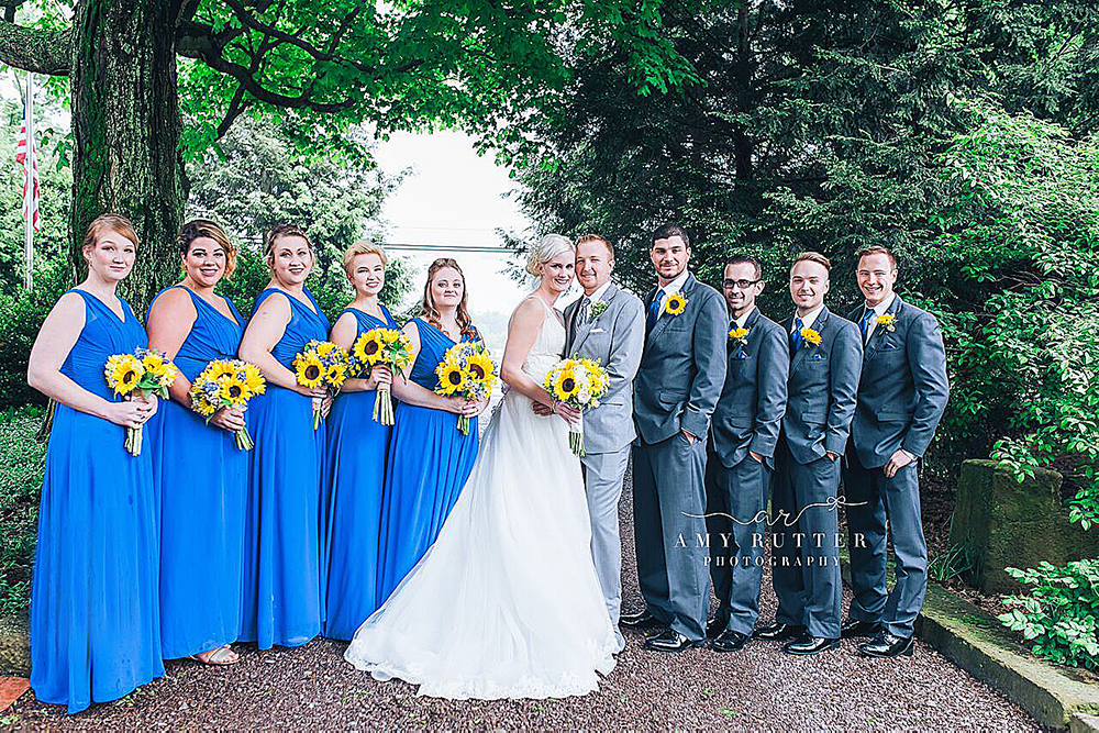 Entire Bridal party brides maids in blue dresses.