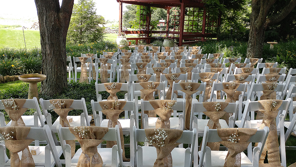 Photo decorated chairs in front of Pergola.