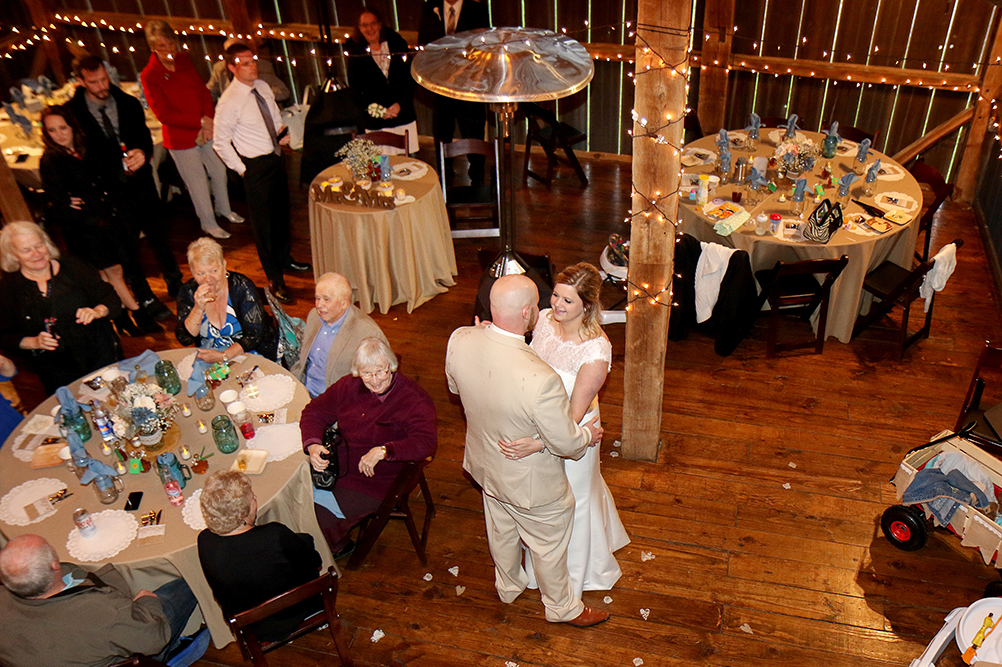 Bride and Groom Dancing in the Barn