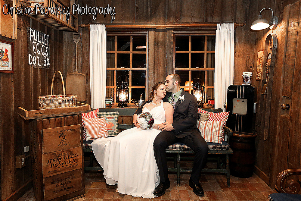 Bride and groom in sitting on a bench in the Stable