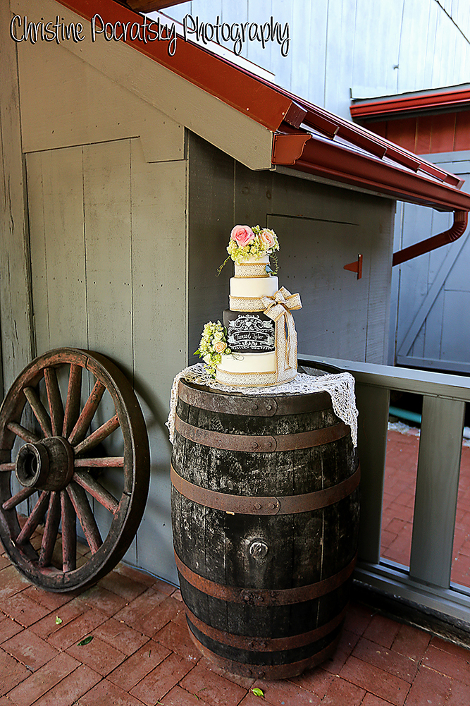 Photo Wedding Cake on top of Barrel in Front of the Barn at Watsons Choice.