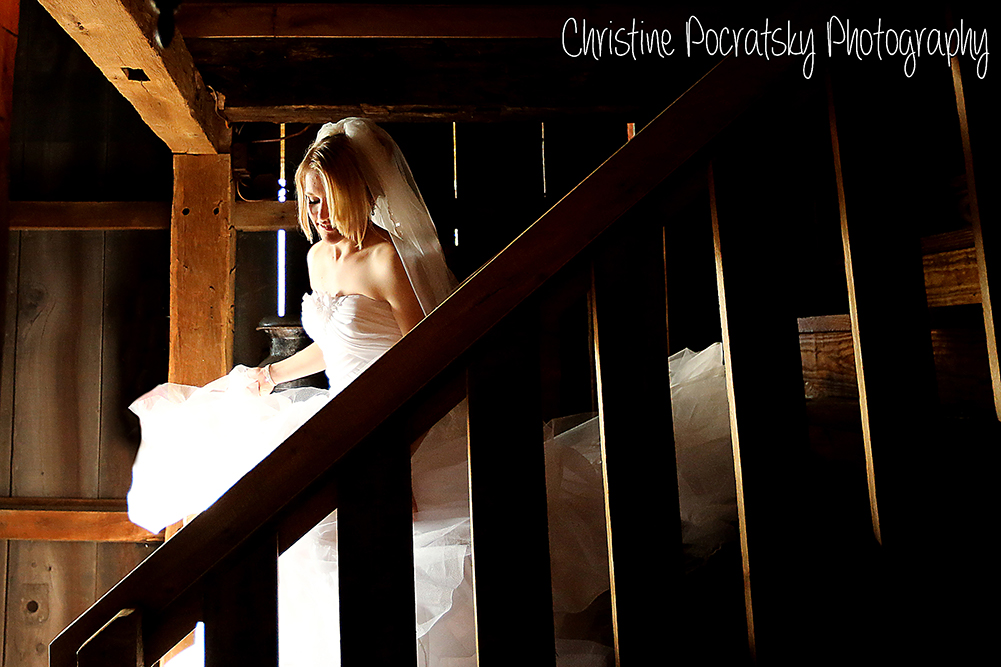 Photo Bride Walking down steps in the barn.
