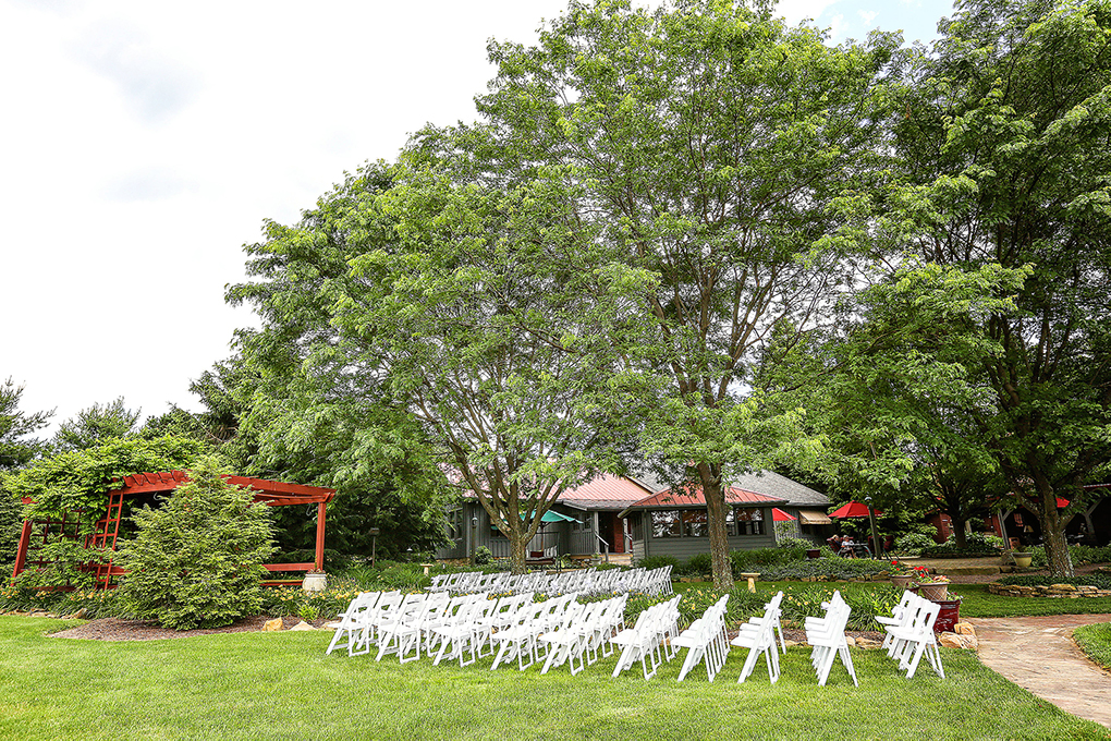 Photo of chairs in front of Pergola side view.