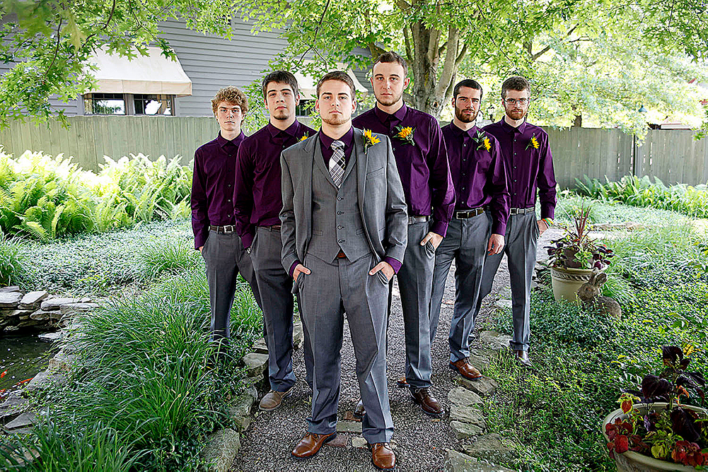 pPhoto of groom and grooms men ion the patio.