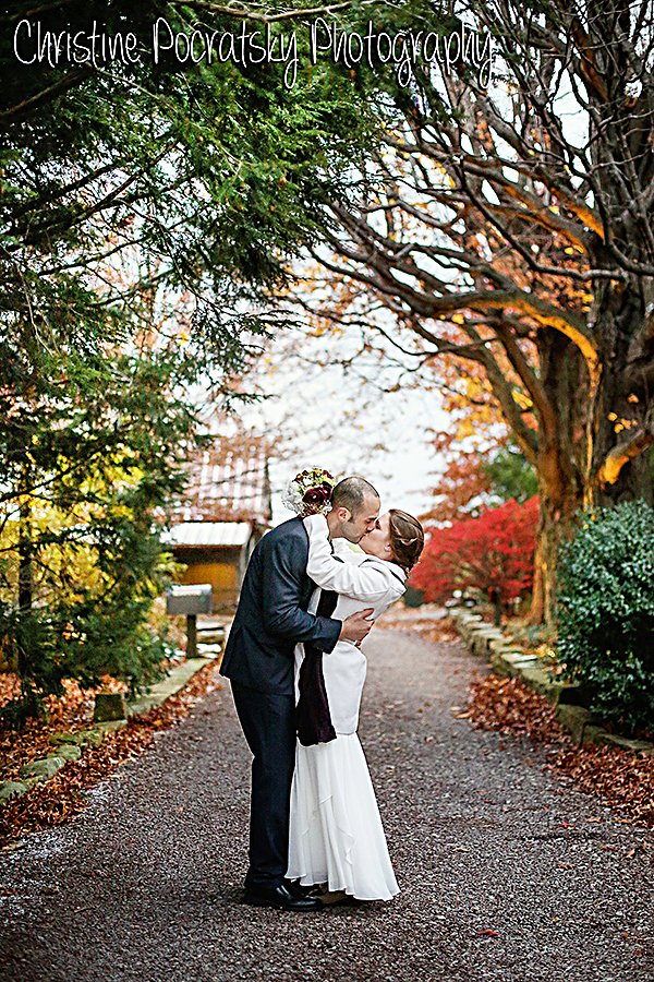 Photo Bride and Groom Kissing on a path at Watsons choice.