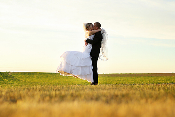 Bride groom in field at Watsons Choice.