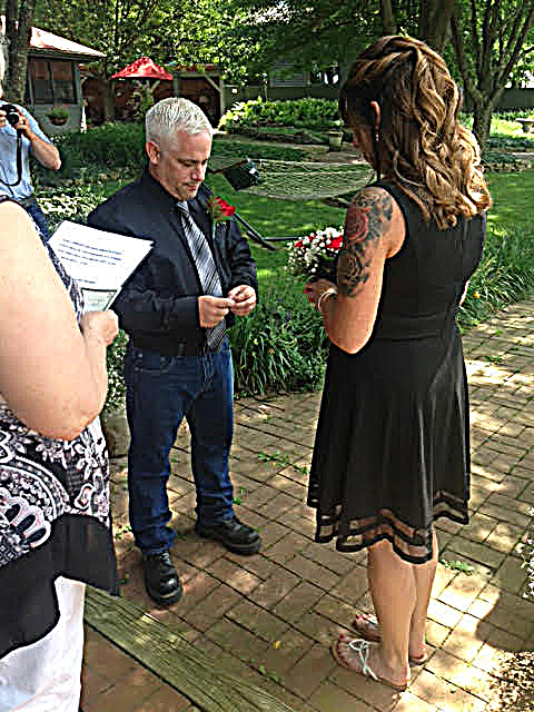 Photo of elopement couple exchanging rings.