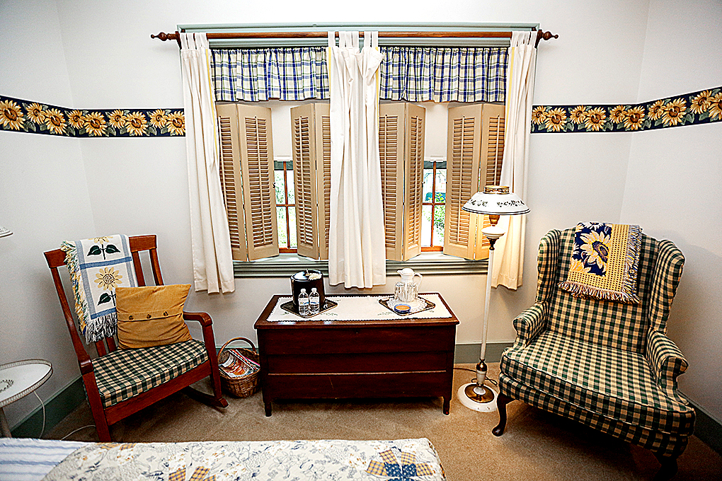 Sunflower Twin Beds Room, looking at the windows and the chairs.