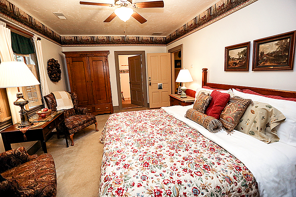 Woodlands King room with view of the bed.