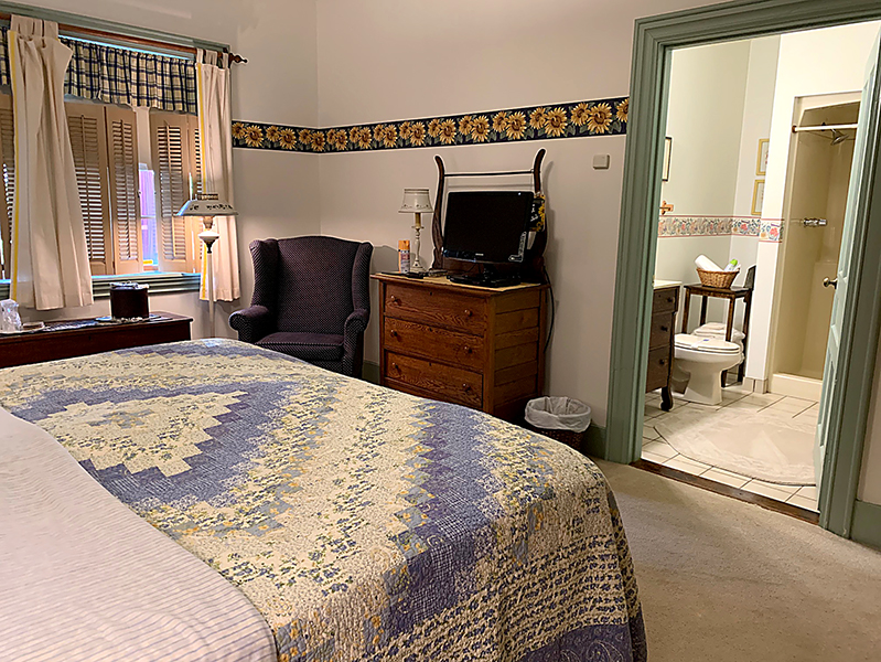 Sunflower room at the inne at Watsons choice, with a king bed.